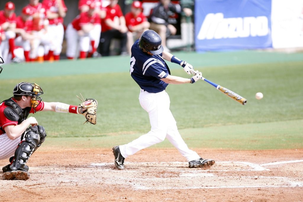 College baseball hitter using a BBCOR baseball bat.