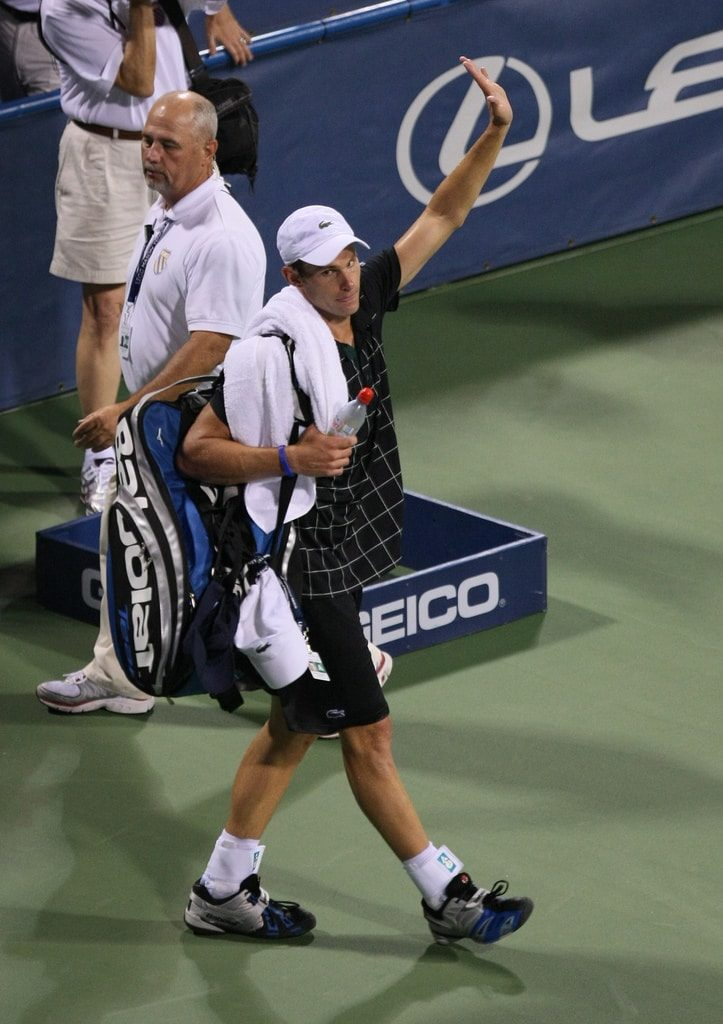 Andy Roddick carrying his tennis bag.