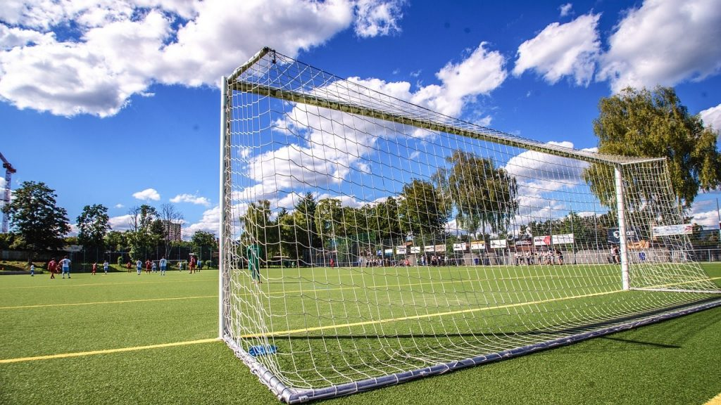 A full-size soccer goal with a steel frame.