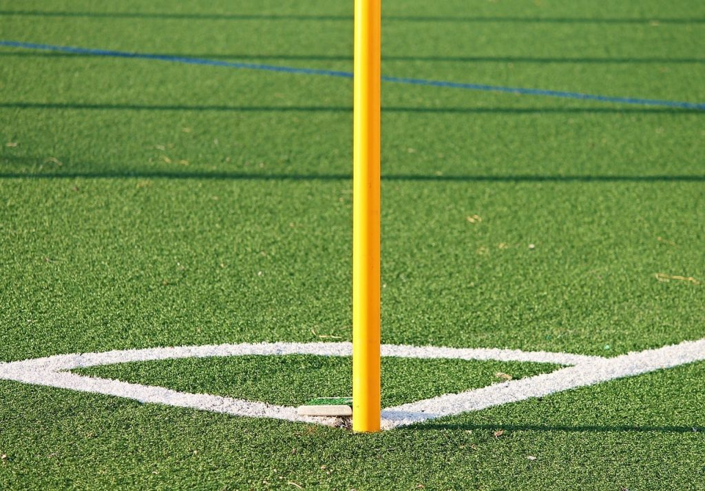 The corner flag on an artificial soccer pitch.