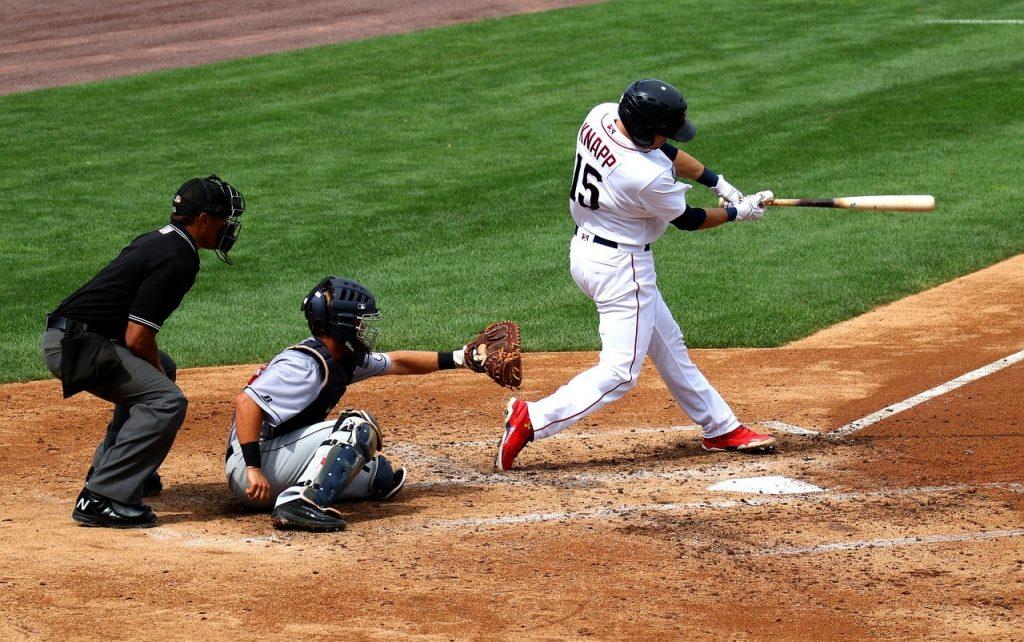 Baseball batter hitting the ball.