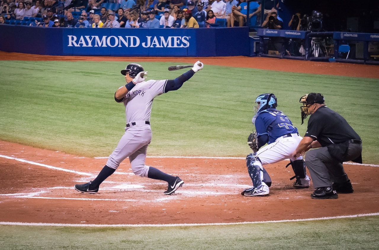 A baseball batter hitting a home run.