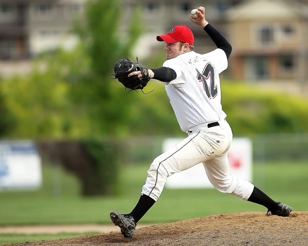 A baseball pitcher throwing a pitch.