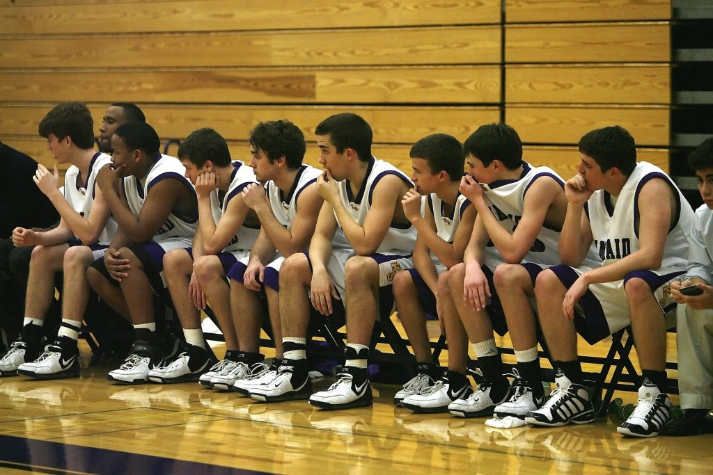 A basketball team on the bench.