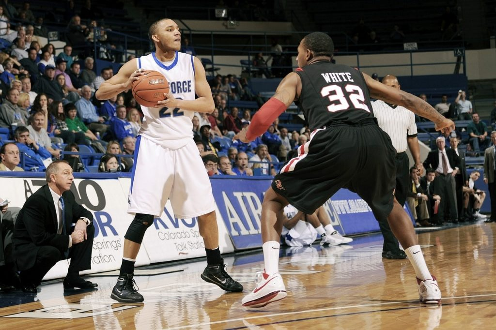 A basketball player about to make a pass.