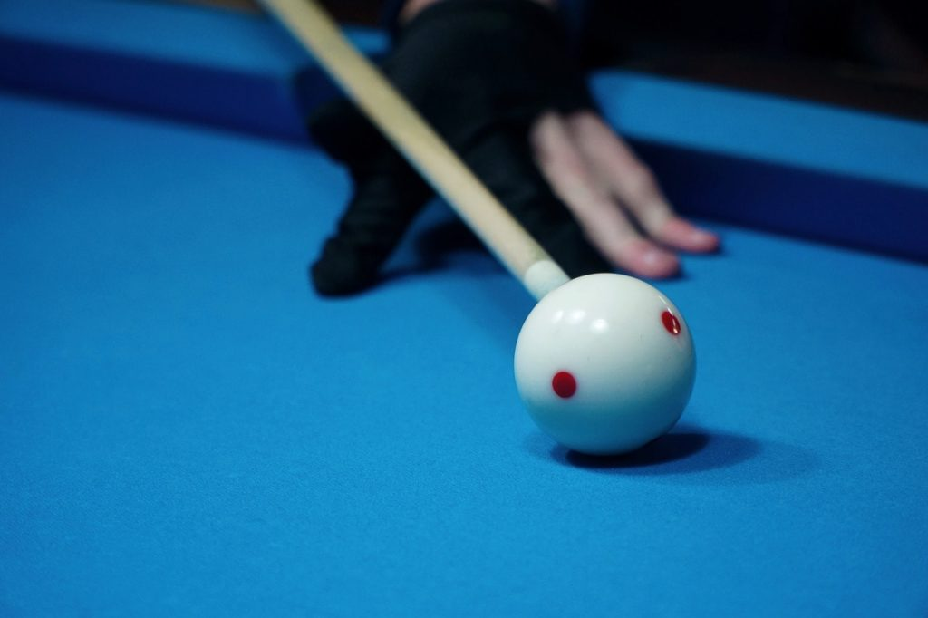 Pool player using a billiard glove.