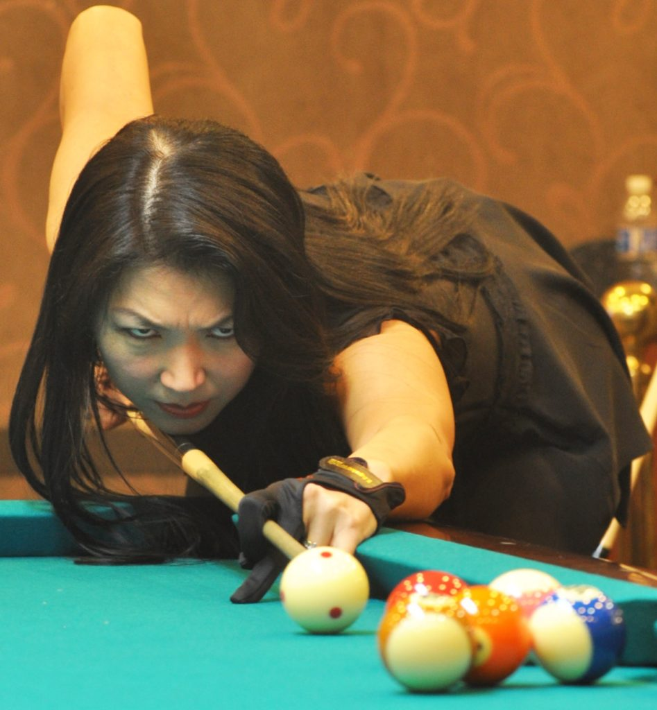 Jeanette Lee AKA The Black Widow playing pool.