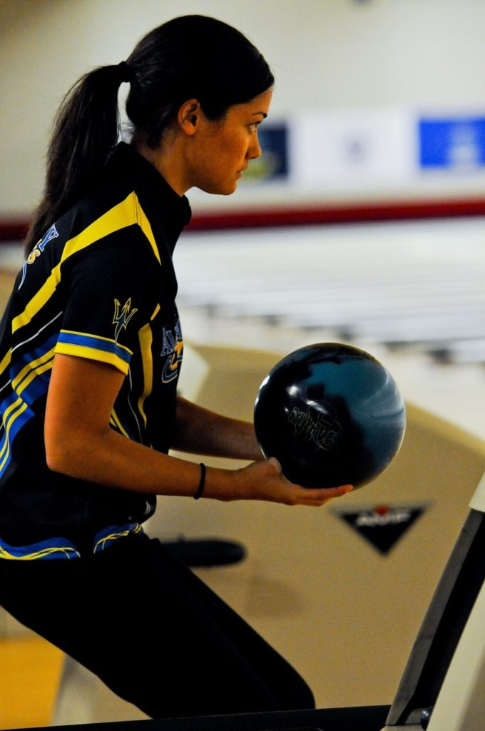 Woman playing ten pin bowling.