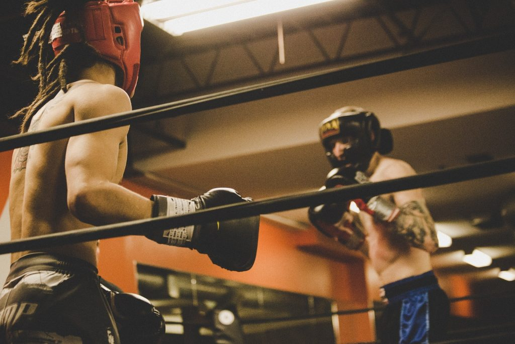 Two boxers sparring in the ring.