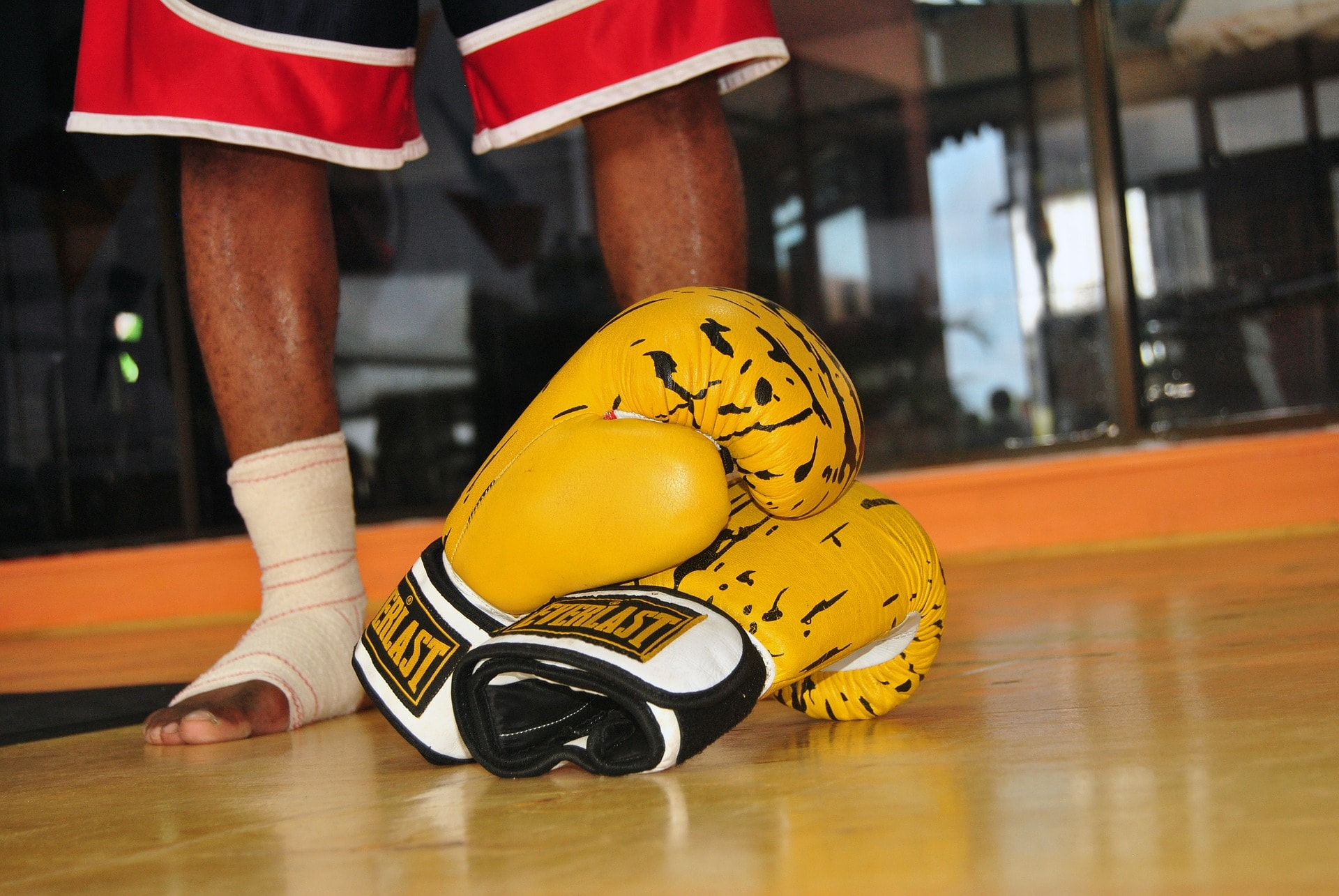Boxing gloves in a boxing ring.