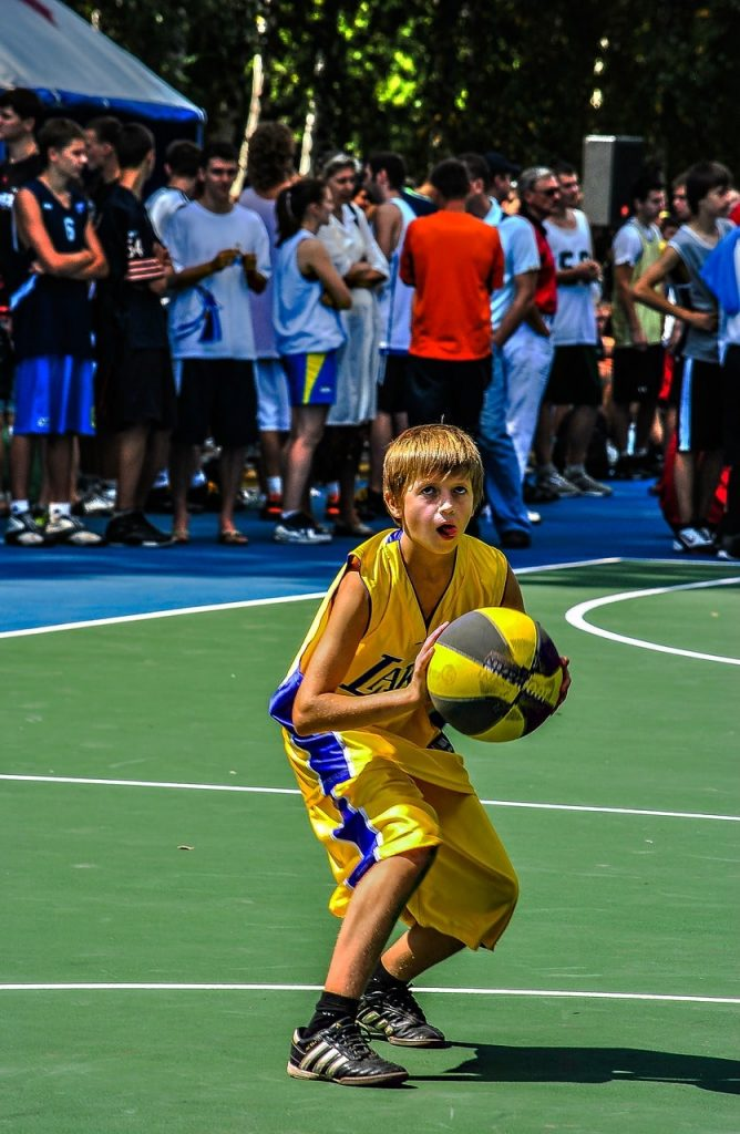 A boy playing basketball.