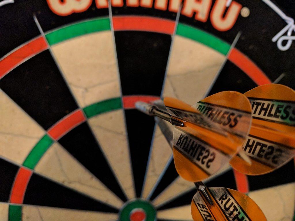 Treble twenty scored on a bristle dartboard.