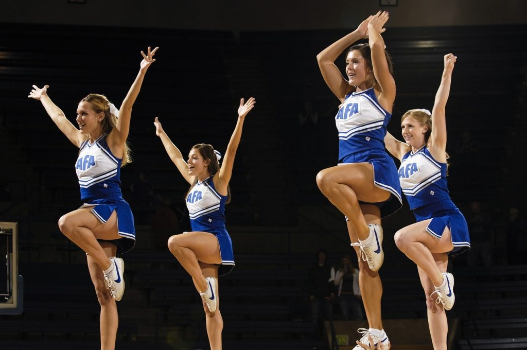 Cheerleaders performing at a basketball match.