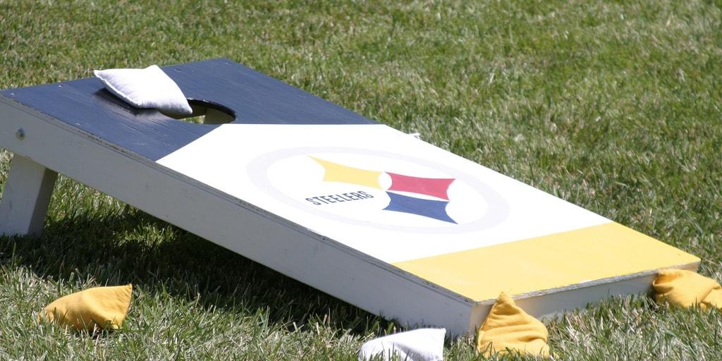 Cornhole board with cornhole bags.