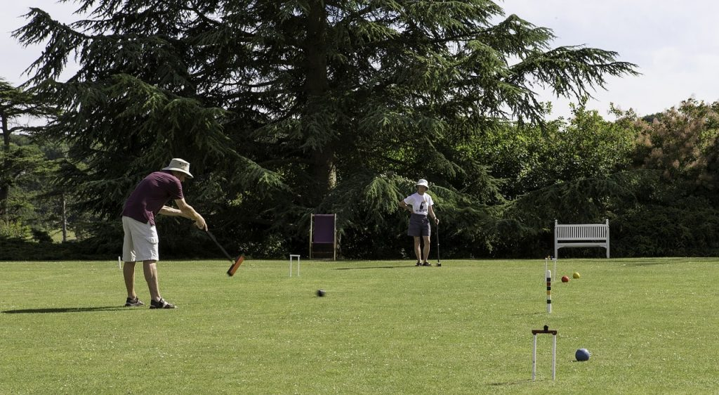 People playing croquet.