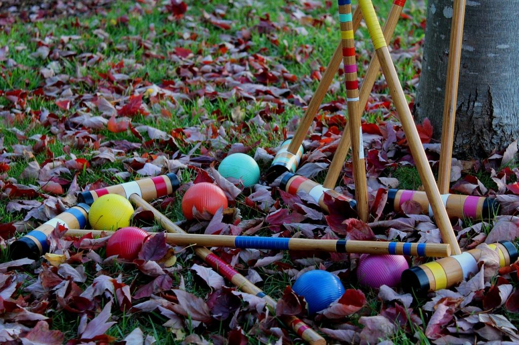 A croquet set including mallets and balls.