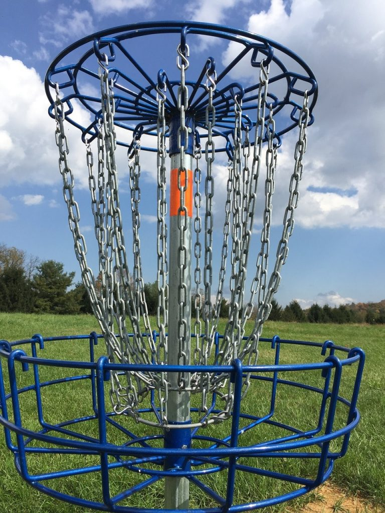 A disc golf basket with metal chains.
