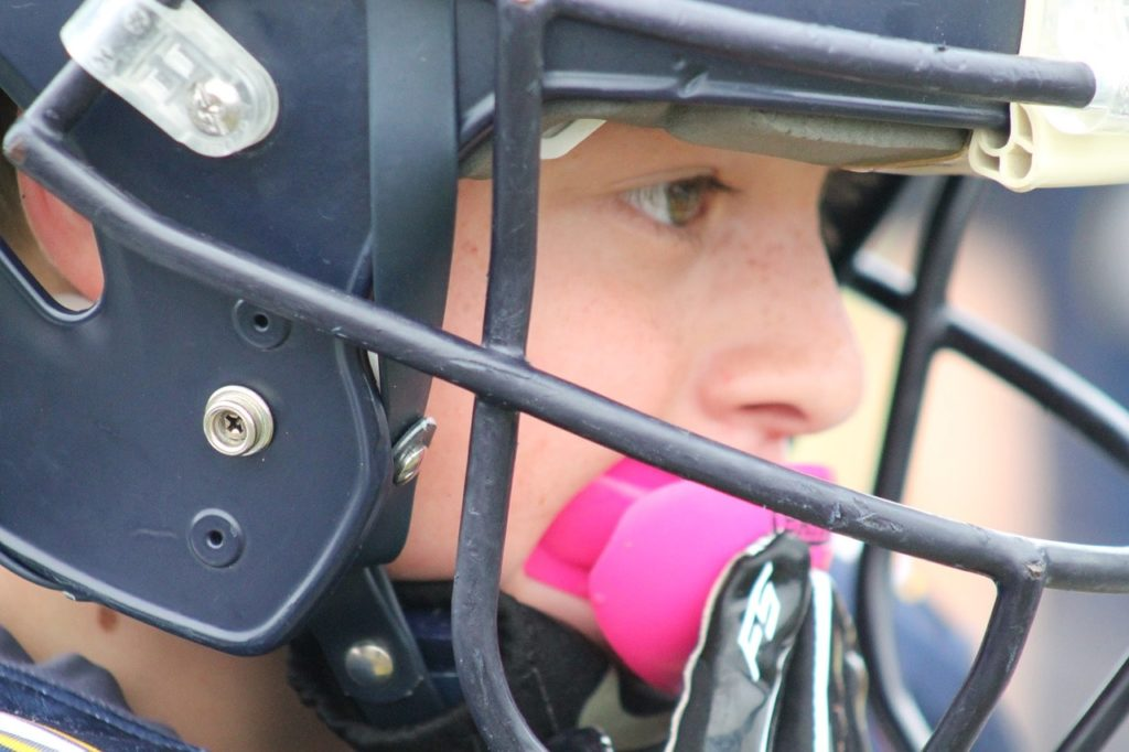 Football player using a mouthguard.
