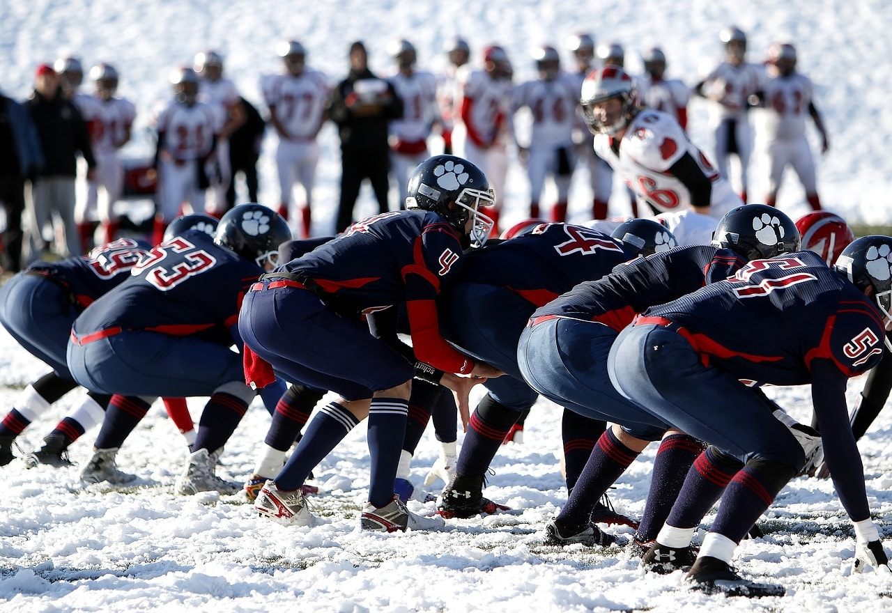 Football cleats being used in the snow.