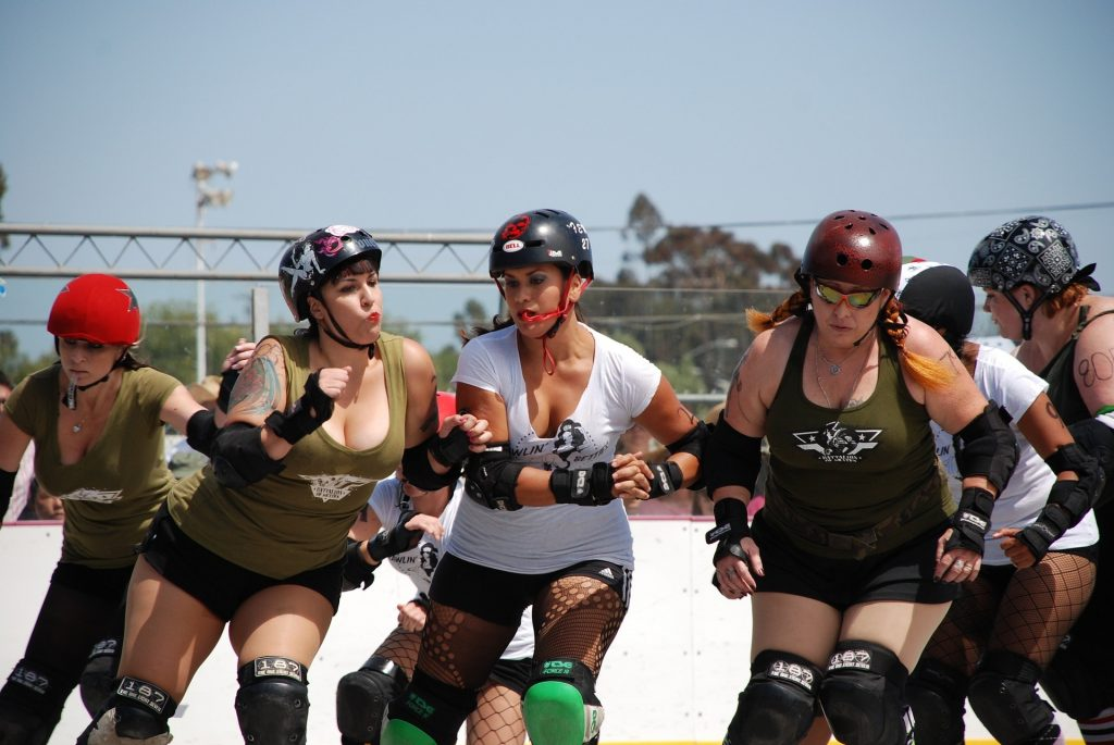 Girls playing roller derby.