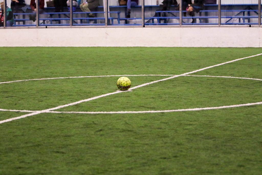 An indoor soccer pitch with carpet turf.