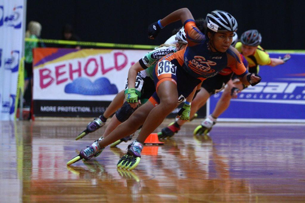 Speed skaters wearing inline roller skates.