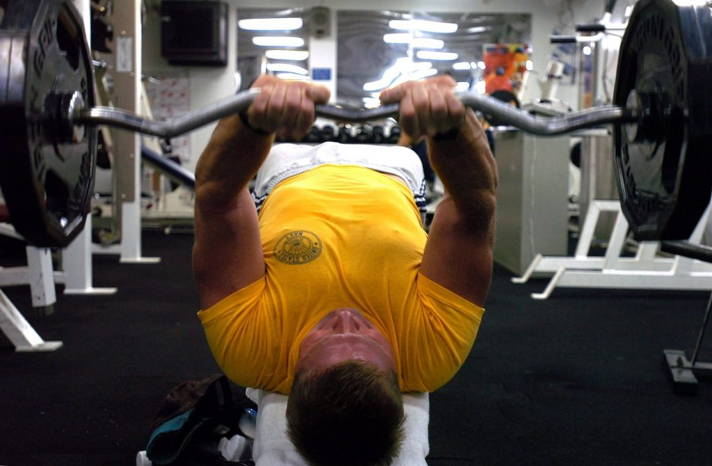 Man bench pressing a barbell.