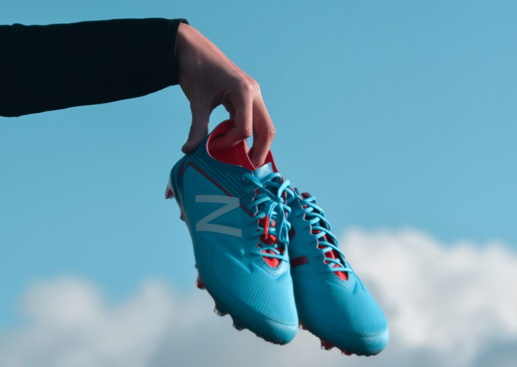 New Balance soccer cleats.