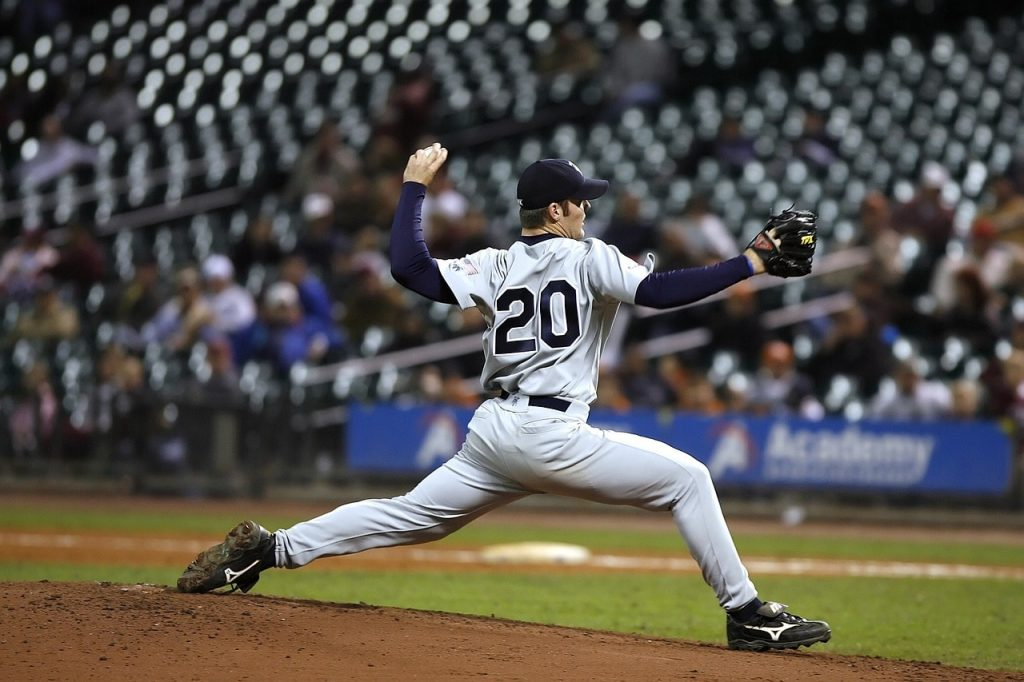 A pitcher throwing a fastball in baseball.