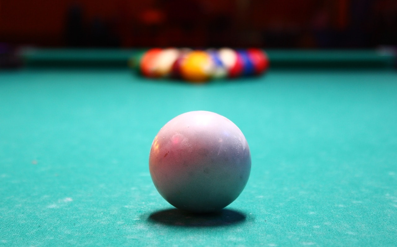 Dirty pool table and cue ball.