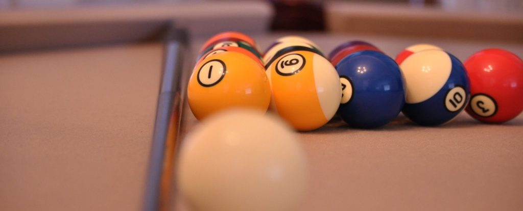 Pool balls resting on a pool table.