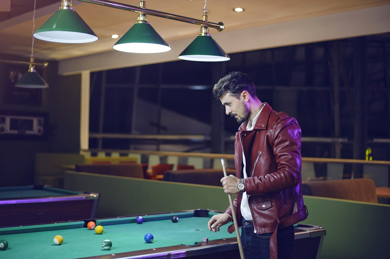 Man playing on a pool table.