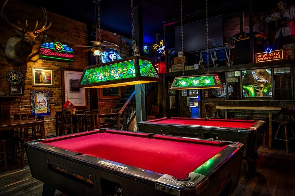 A pool hall using stained glass lighting.
