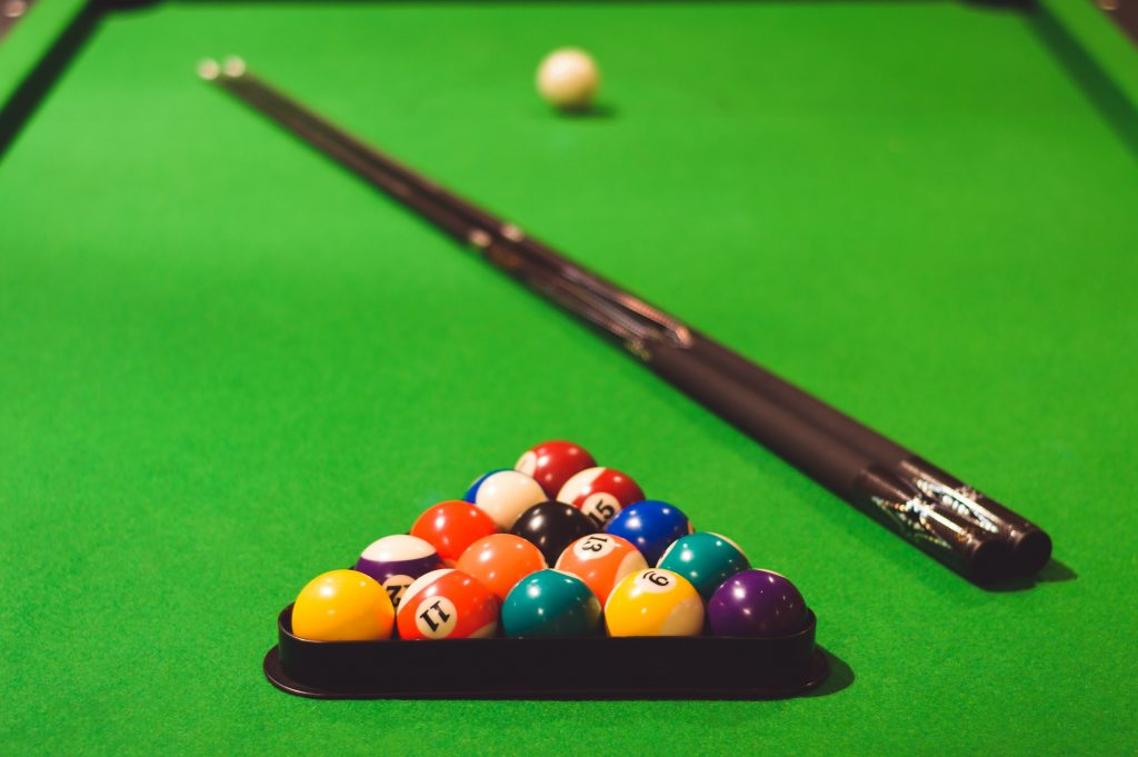 Pool table with pool balls on it.