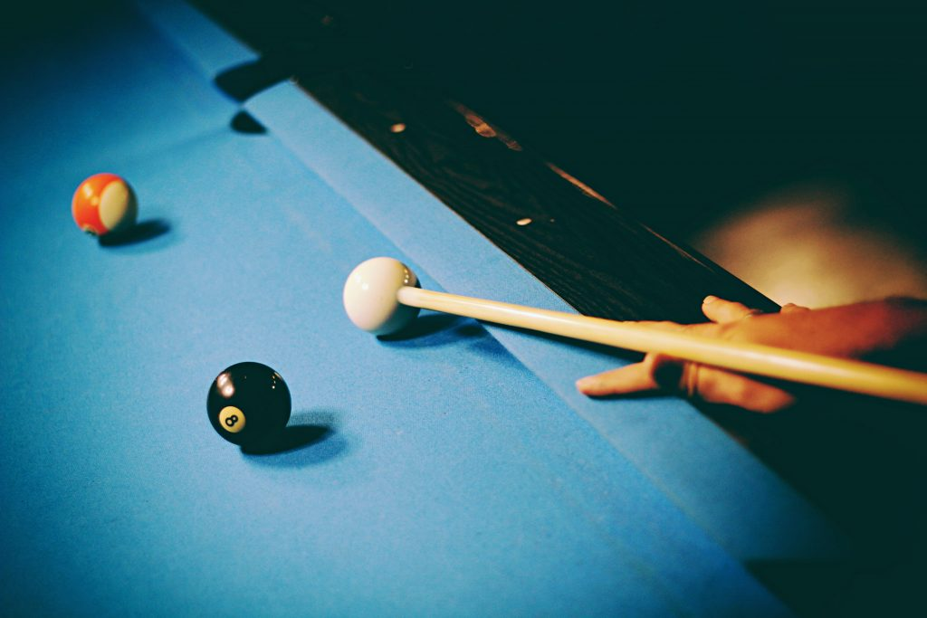 Pool table with blue felt.