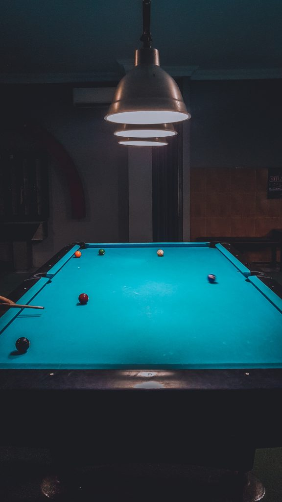 Pool table under lights.