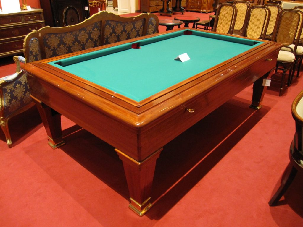 Pool table with ornate straight legs.