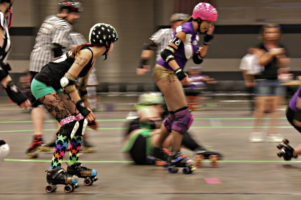 Roller derby players skating.