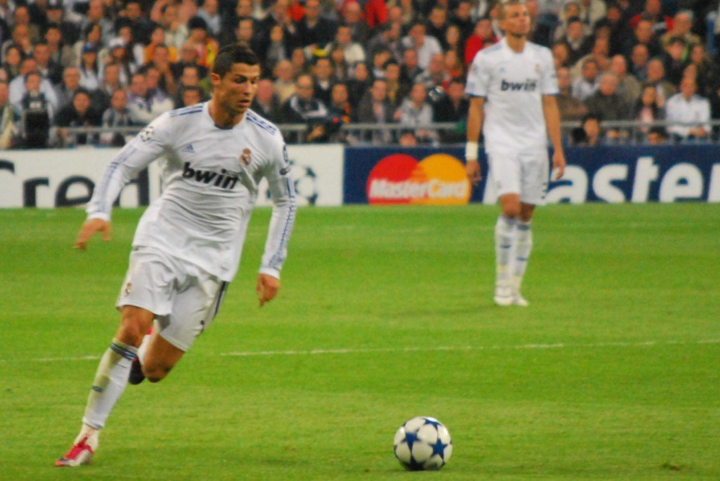 Cristiano Ronaldo playing with an Adidas Champions League official match ball.