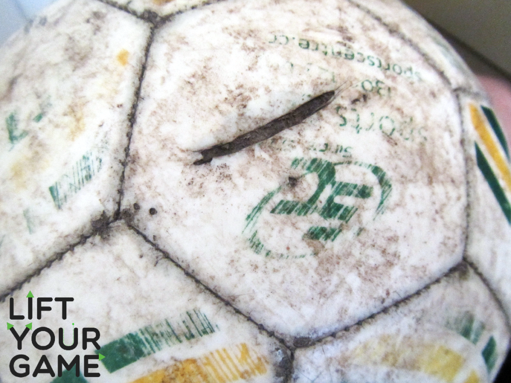 A soccer ball with a deep cut.
