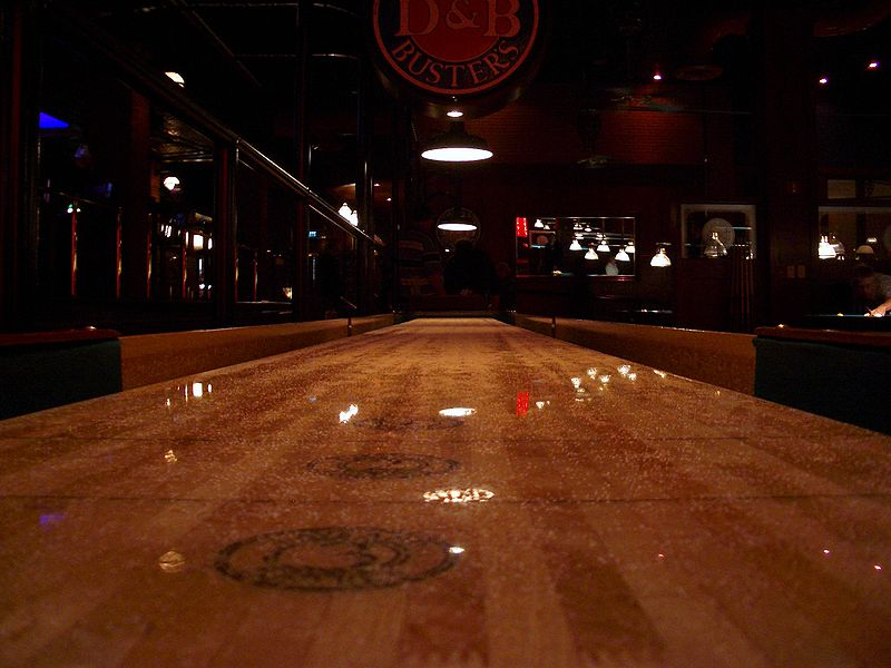A shiny shuffleboard table.