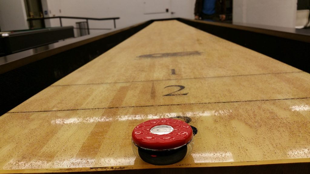 Shuffleboard table markings.