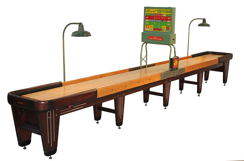 Shuffleboard with an electronic scoring mechanism.