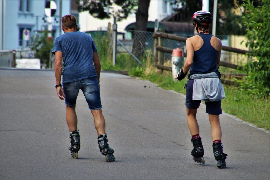 Couple skating using inline roller skates.