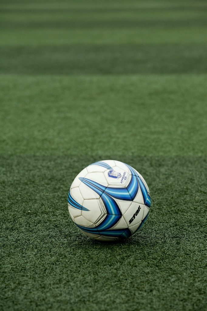A soccer ball resting on artificial turf.