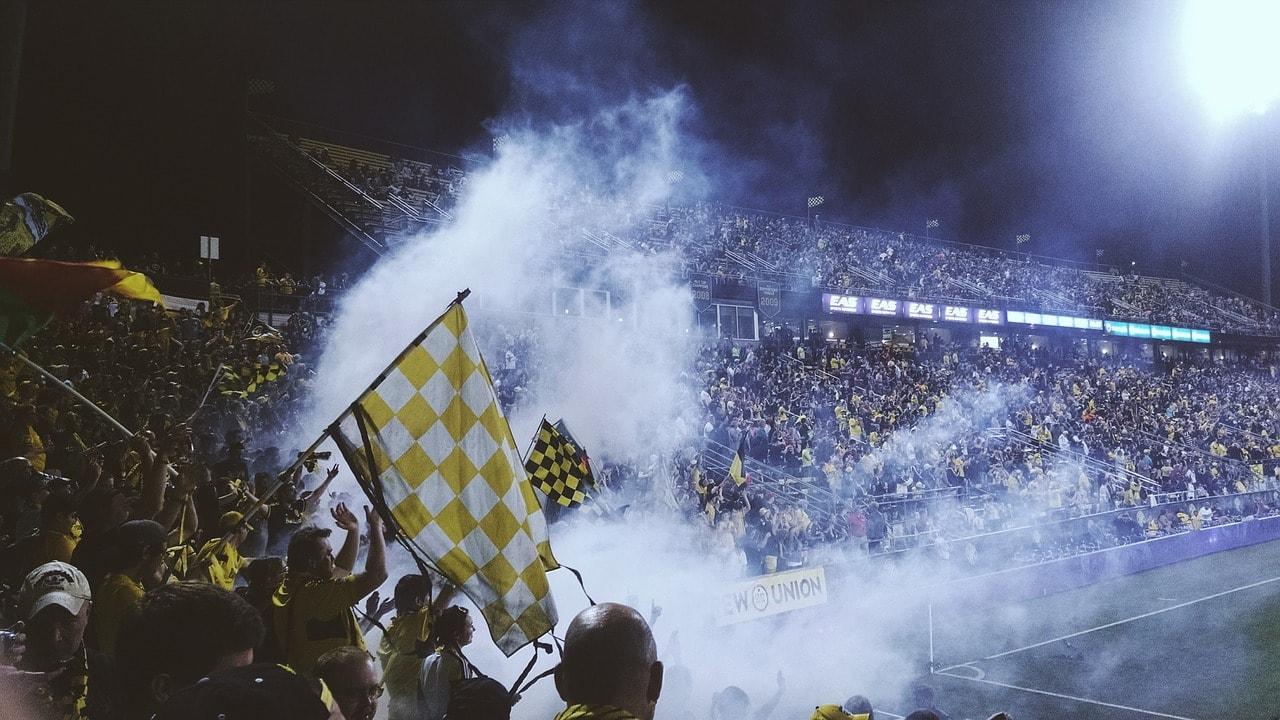 Soccer fans at a soccer stadium.