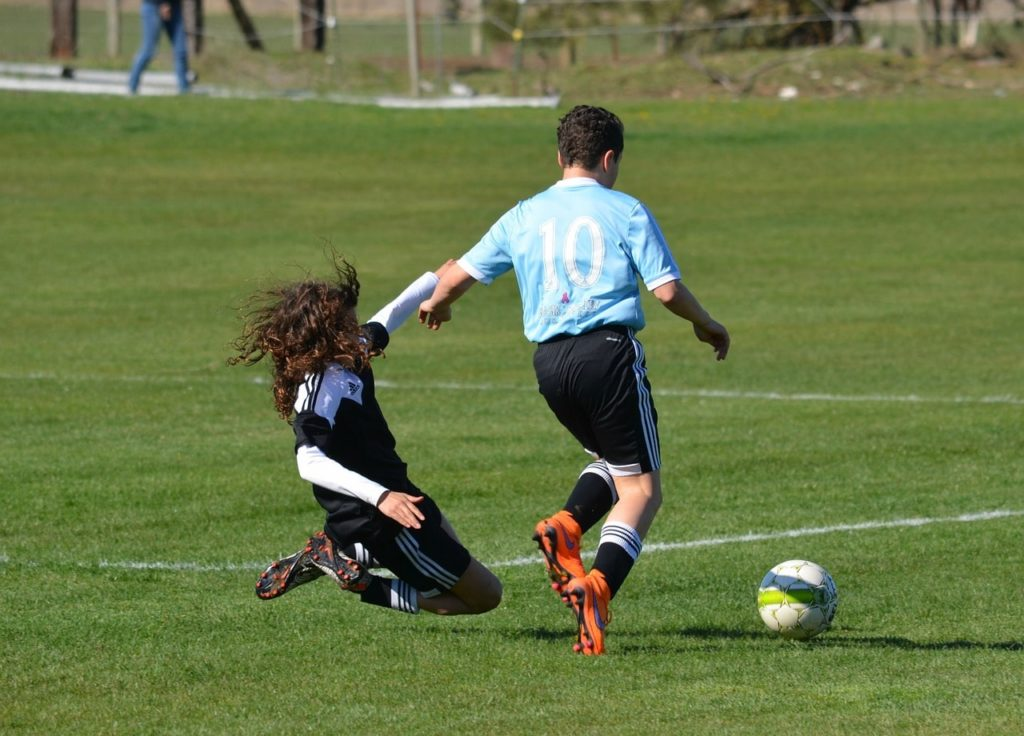 Soccer player making a slide tackle.