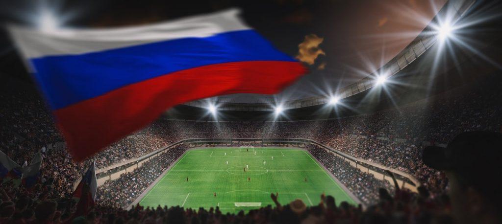 A Russian soccer fan waving a flag,