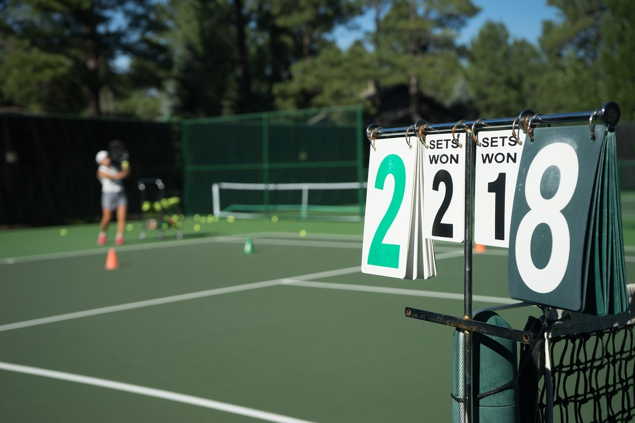 Tennis court with scoreboard.