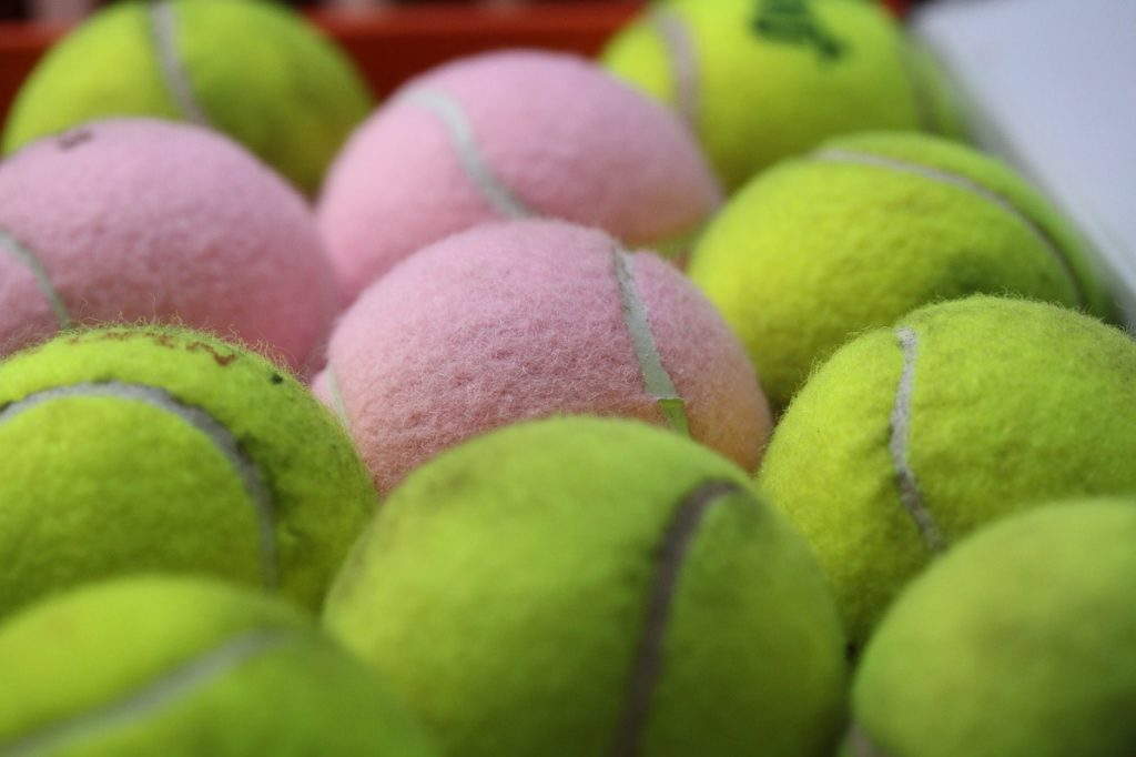 Different colored tennis balls.